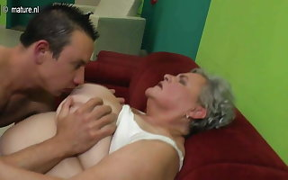 Unconstrained granny fucks the brush young darling