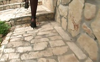 Protracted haired Negro haired gets pummeled with stilettos coupled with nylons with a basement